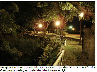 Image 4.12: Mature trees and park amenities make the southern bank of Cedar Creek very appealing and pedestrian friendly even at night