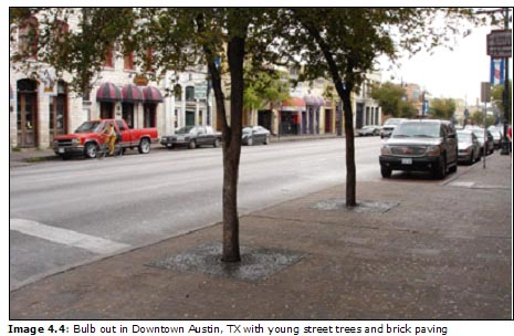 Image 4.4: Bulb out in Downtown Austin, TX with young street trees and brick paving